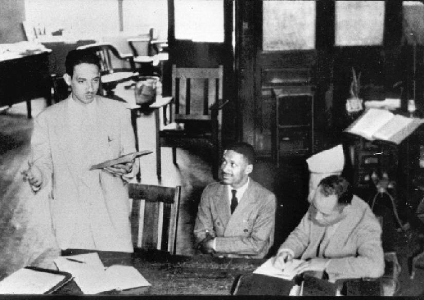 Thurgood Marshall stands in a Baltimore courtroom with his client, Donald Gaines Murray